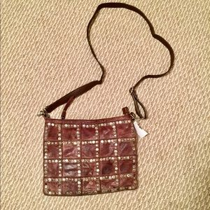 Brown studded leather cross body zip top bag